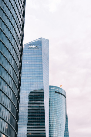 Madrid, Spain - June 25, 2017: Low angle view of skyscrapers in Cuatro Torres Business Area, CTBA (Four Towers Business Area) a business district in Madrid against cloudy sky Editorial