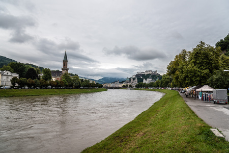 Salzburg, Austria - August 6, 2017: Scenic view of river  in Salzburg. The Old Town of Salzburg is internationally renowned for its baroque architecture and was listed as a UNESCO World Heritage Site. Redakční