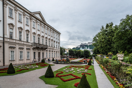 Salzburg, Austria - August 6, 2017: Scenic view of Mirabell Gardens in Salzburg a rainy day of summer. The Old Town of Salzburg is internationally renowned for its baroque architecture and was listed as a UNESCO World Heritage Site. Redakční