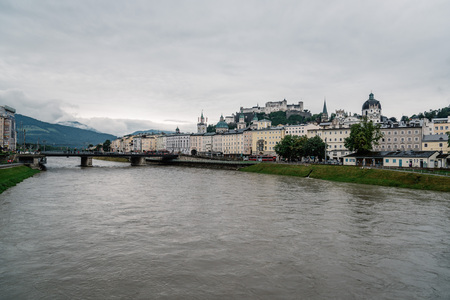 salzach: Salzburg, Austria - August 6, 2017: Scenic view of river  in Salzburg. The Old Town of Salzburg is internationally renowned for its baroque architecture and was listed as a UNESCO World Heritage Site. Editorial
