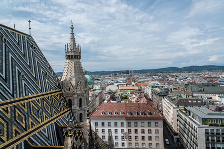 Vienna, Austria - August 16, 2017: Panoramic view of Vienna from the roof of Cathedral of St Stephen. Built in romanesque and gothic style, with its multi-coloured tile roof is a citys symbols