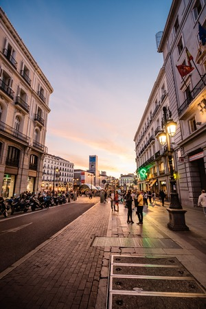 Scenic view of street in city centre of Madrid at sunset Editorial