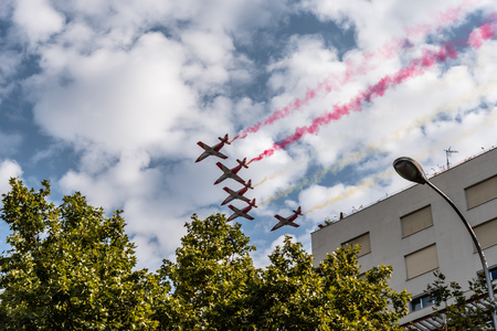 Aguila Patrol jet fighters flying with coloured smoke