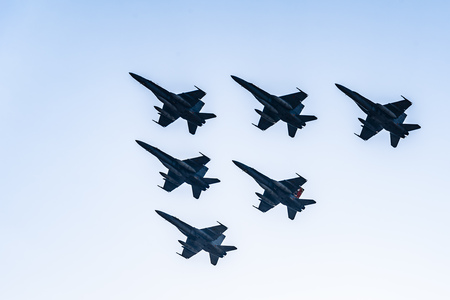 Six F18 Hornet jet fighters flying a blue sky day