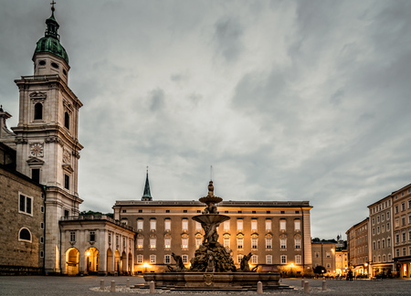residenz: Salzburg, Austria - August 6, 2017: Scenic view at sunset of Residenzplatz in Salzburg. The Old Town of Salzburg is renowned for its baroque architecture and is a UNESCO World Heritage Site. Editorial