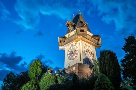 Graz, Austria - August 11, 2017: The Schlossberg at night. It is a tree-clad hill, and the site of a fortress, in the centre of the city of Graz, Austria. Editorial