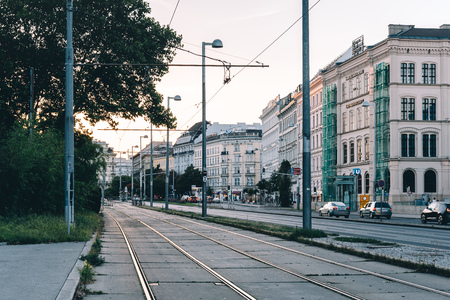 Tramways in Karlsplatz in Vienna at sunset