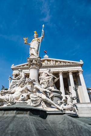 Pallas Athena fountain and Austrian Parliament Building Editorial