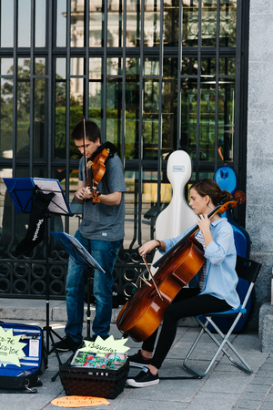 Musical quartet playing at the entrance of Opera Palace in Madri