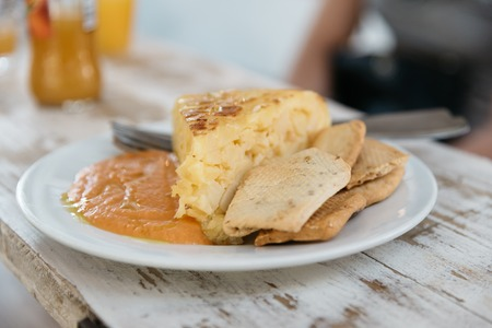 Close up of plate of spanish omelette with salmorejo, a typical Foto de archivo