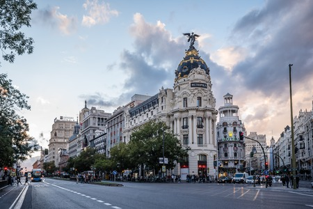 Gran Via street and Metropolis Building in Madrid Editorial