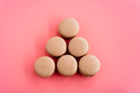 Macarons isolated on pink background Stock Photo
