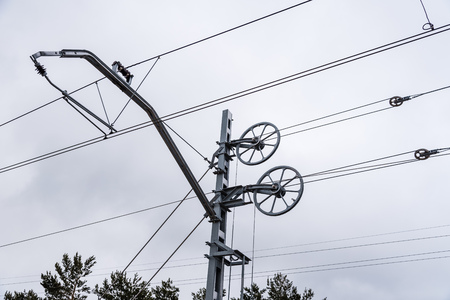 Catenary wires for power supply to railway against sky Stock Photo