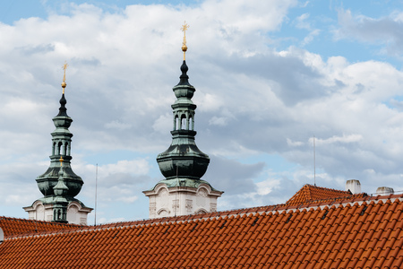 Spires and roof of Strahov Monastery in Prague Stock Photo