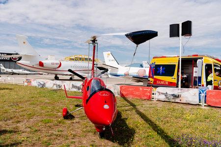 Red color ELA 07 autogiro during air show Editorial