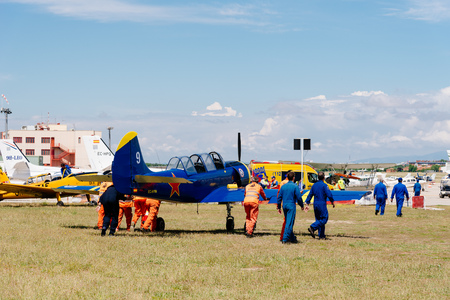 Madrid, Spain - June 3, 2018: Yak 52 Russian aerobatic aircraft during air show of historic aircraft collection in Cuatro Vientos airport