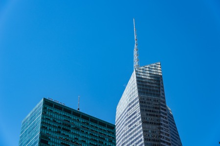 Low angle view of modern office buildings against sky in New Yor