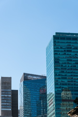 Low angle view of modern office buildings against sky in New York Editorial