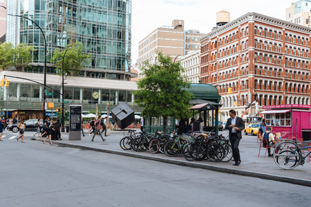 Street scene in New York with people crossing and bicycles