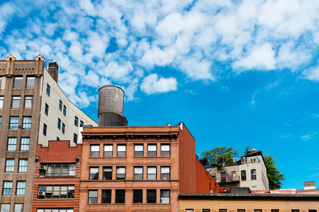 Cityscape of New York with old buildings and water tower Фото со стока
