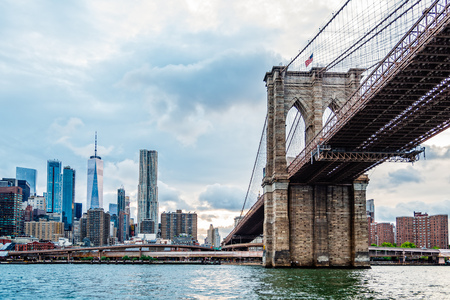 Skyline of Downtown of New York and Brooklyn Bridge from East River at sunset Stock Photo