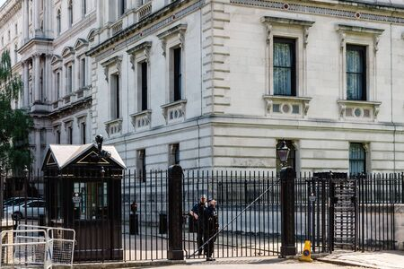 Police officers guarding Downing Street in London Editorial