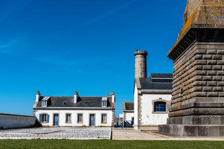 Eckmuhl Lighthouse in Brittany against blue sky