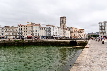 La Rochelle, France - August 7, 2018: The old port. Enclosed by its medieval towers, the picturesque harbour is now lined with seafood restaurants and bars