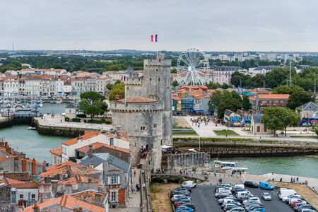 La Rochelle, France - August 7, 2018: High Angle View of the Old Port of La Rochelle and the historic town a cloudy day of summer