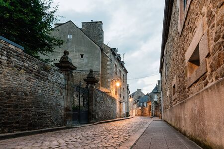 Stone medieval houses in cobblestoned street in Dinan