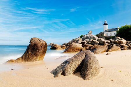 Scenic view of beach and lighthouse in Brittany