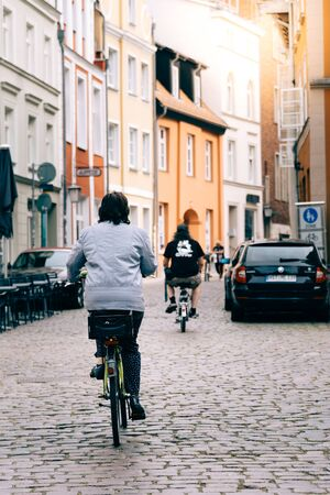 Cyclists riding at the old town of Stralsund