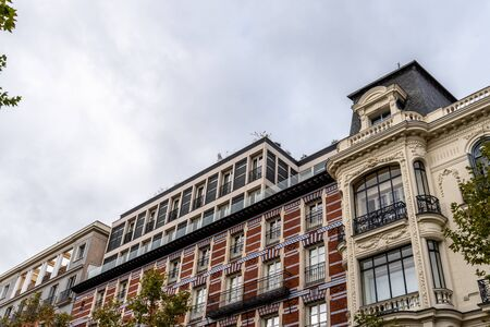Old luxury residential buildings with balconies in Serrano Street in Salamanca district in Madrid