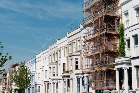 Traditional townhouses in Notting Hill, one of which is being renovated, London