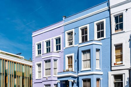 Colorful townhouses near Portobello Road in Notting Hill, London.
