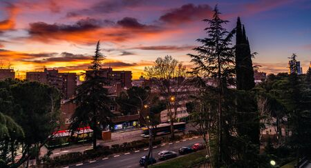 Dramatic sunset on cityscape of Madrid. Global warming concept