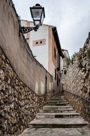 Cobblestoned street and steps in the medieval town of Pastrana, Spain.