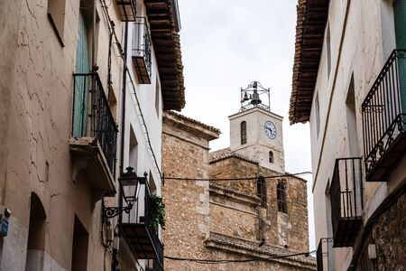 View of the streets of the medieval town of Pastrana with the church clock tower