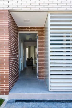 Modern semi-detached houses in minimalistic shape. Exterior view of the entrance 写真素材