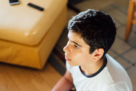 Head shot of young boy concentrating on playing video games Archivio Fotografico