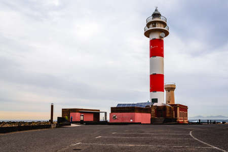 Scenic view of El Toston Lighthouse in Canary Islands amidst volcanic landscape Standard-Bild - 156711542