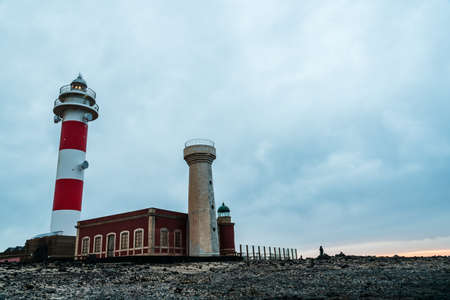 Scenic view of El Toston Lighthouse in Canary Islands amidst volcanic landscape