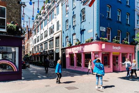 People shopping in Carnaby Street in Soho in London