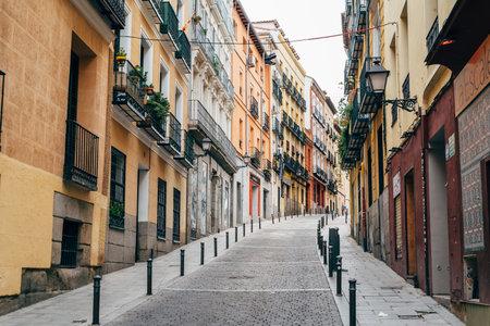 Typical street in Lavapies amidst old residential buildings in Lavapies in Madrid