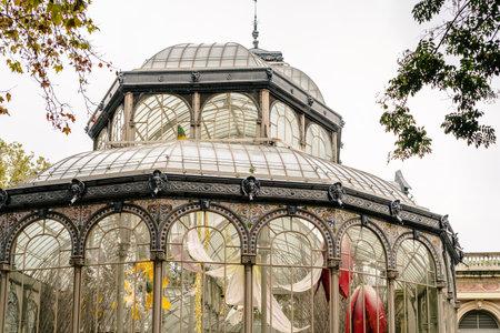 Palacio de Cristal or Glass Palace in Buen Retiro Park during Autumn