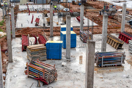 Construction site with reinforced concrete columns, struts and structural formworks