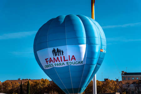 Big blue balloon with the banner Family Freedom for Education in Plaza de Colon in Madrid