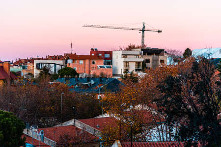 cityscape of residential district at sunset during Autumn
