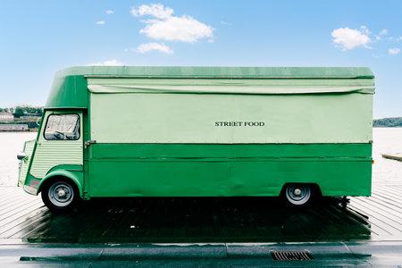 Green retro food truck parked   by  sea 版權商用圖片