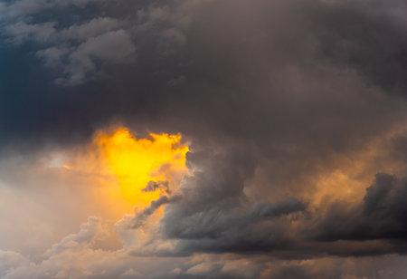 Beautiful dramatic stormy clouds at sunset. Cumulonimbus cloud